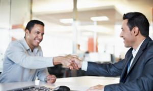 advisor shaking hands with client