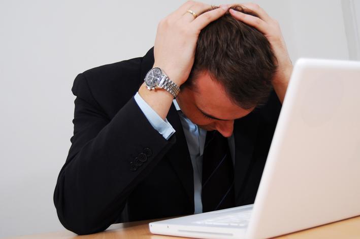 sad man looking at computer